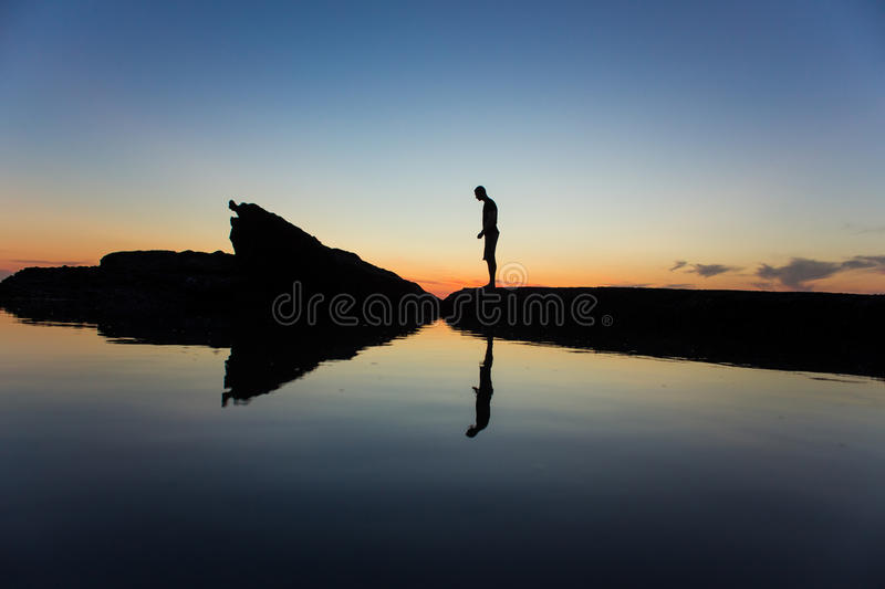 Silhouette Of Man Standing Near Body Of Water During Yellow Sunset Free Public Domain Cc0 Image