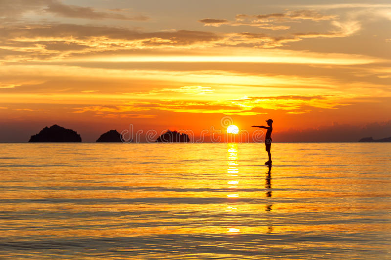 Silhouette of a man standing in the sea at sunset islands background on a tropical island. Koh Samui, Thailand royalty free stock images