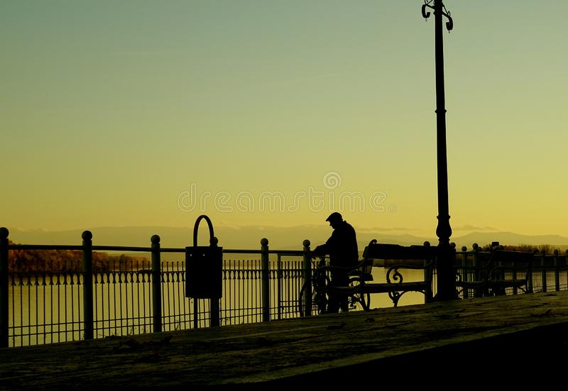 Silhouette Man on Street in City at Sunset royalty free stock images