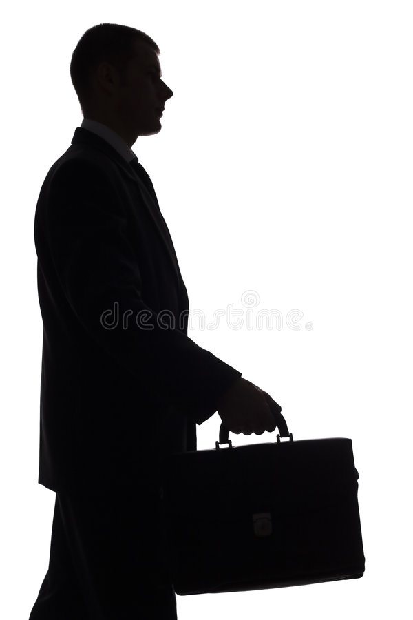 Silhouette of man with suitcase stock photo