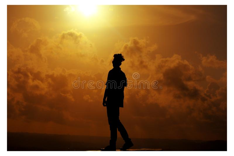 Silhouette of Man During Sunset stock images