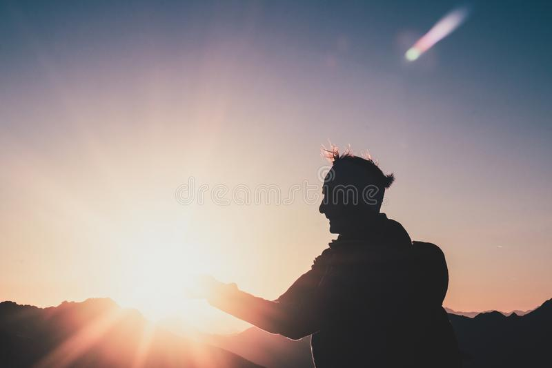 Silhouette of Man during Sunset stock photography