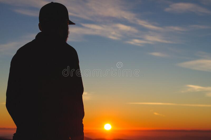 Silhouette of a Man With Sunset Fixture stock image