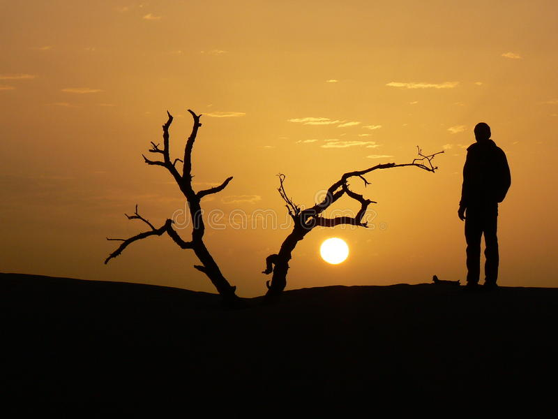 Silhouette of man and sunset. (Morocco stock images