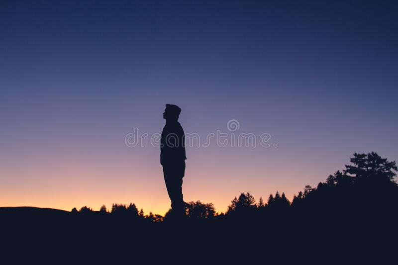 Silhouette of man at sunset stock photography