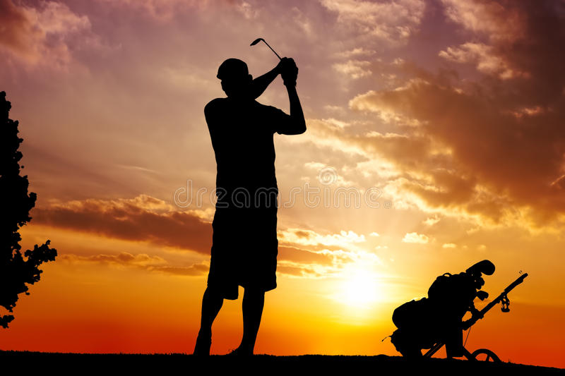 Silhouette of a man swinging royalty free stock image