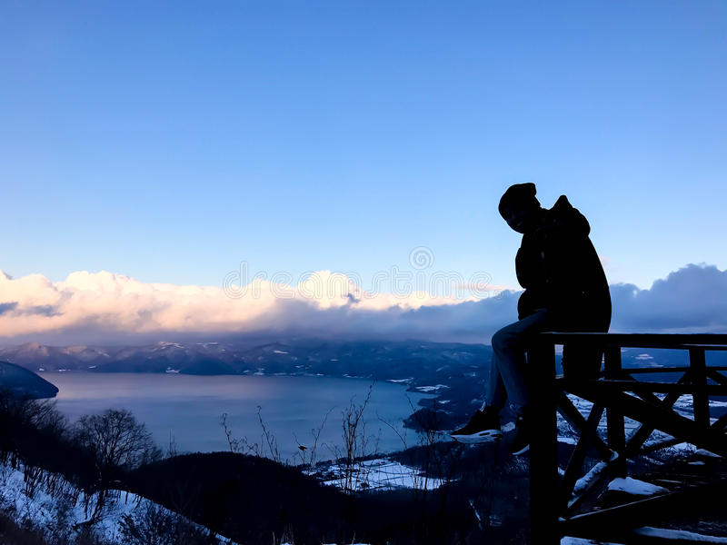 Silhouette man with view fron MT.USUZAN SHOWA SHIN ZAN Hokkaido. Japan royalty free stock photos