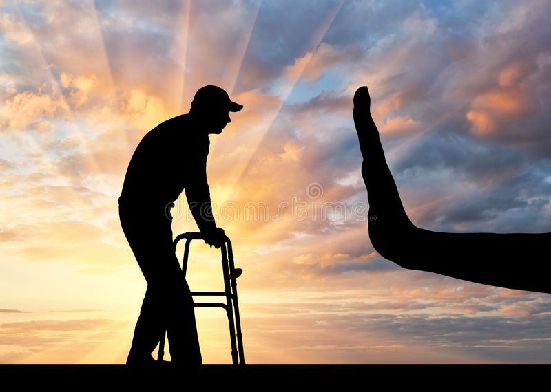 Silhouette of a man with a walker for the disabled and hand gesture stop royalty free stock image