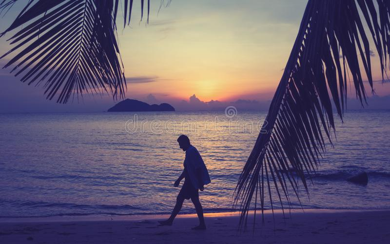 Silhouette of a man walking along the seashore at sunset, man and nature concept, beauty lifestyle freedom vacation vacations stock photography
