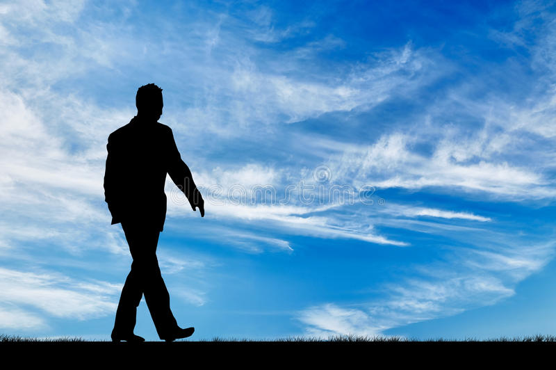 Silhouette of man walking stock images