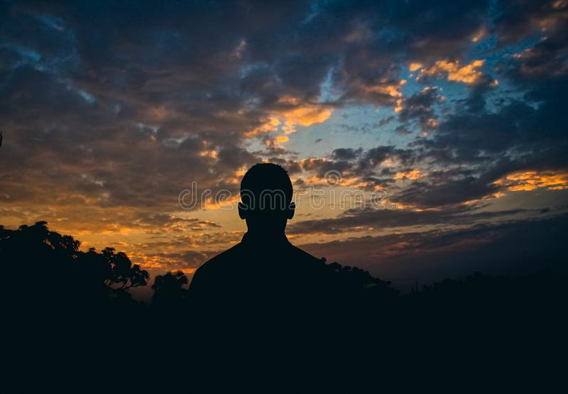 Silhouette Of Man Watching Golden Hour royalty free stock images