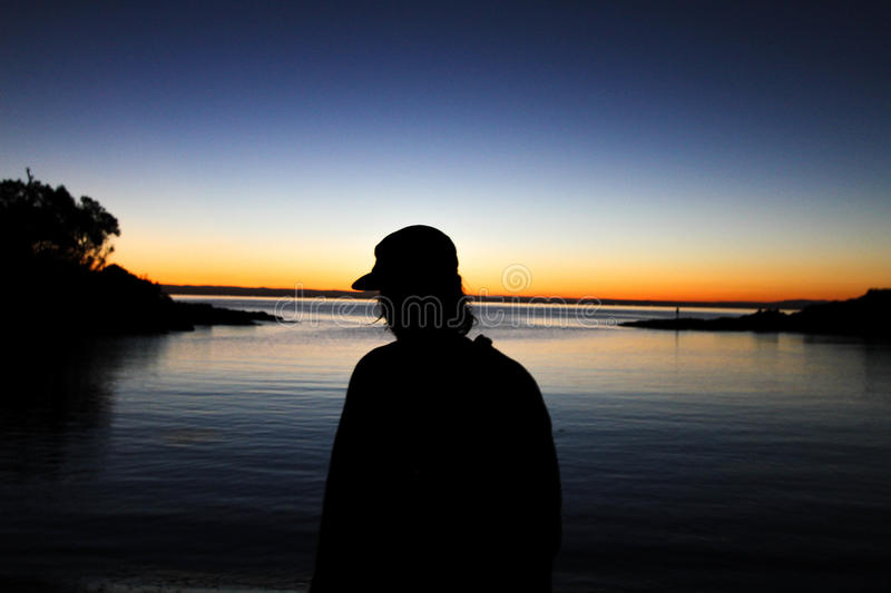 Silhouette Of Man On Waterfront At Sunset Free Public Domain Cc0 Image
