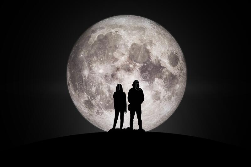 Silhouette of man and women Looking at the moon. Silhouette of man and women  Looking at the moon with hope Fulfillment in love. Elements of this image furnished royalty free stock photo