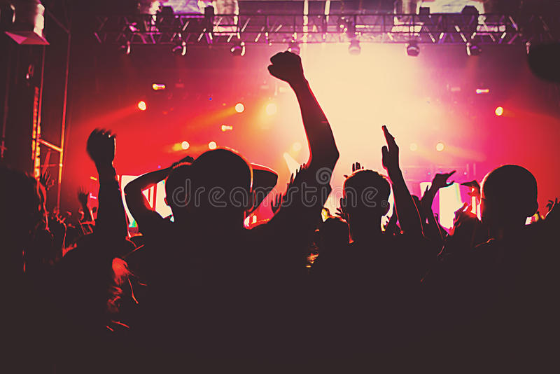Silhouette massive crowd party concert club music. Silhouettes of a massive crowd at the party concert club music happy royalty free stock photography