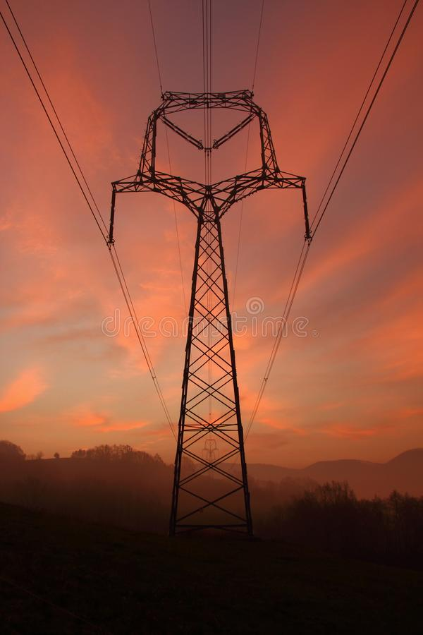 Silhouette mast of a high voltage power line stock image