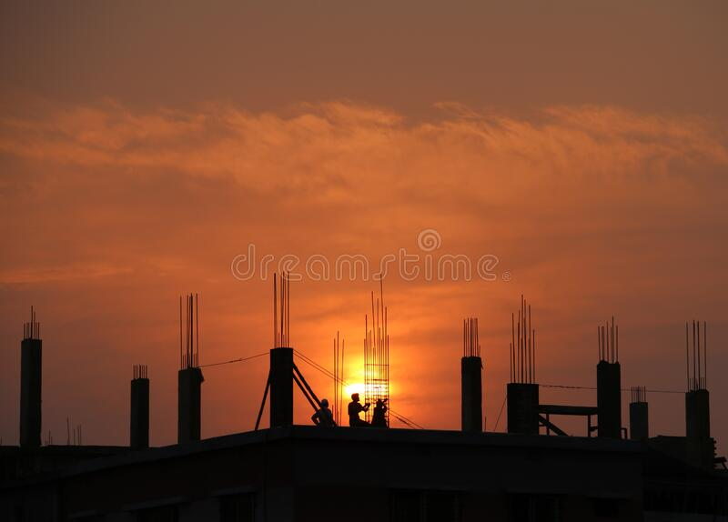 Silhouette of Men in Construction Site during Sunset stock image