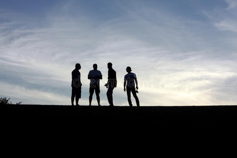 Silhouette of men at twilight royalty free stock photos