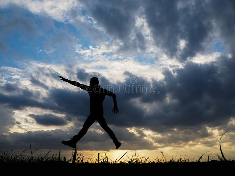 Silhouette. Men or women show joy in success at work. royalty free stock photo