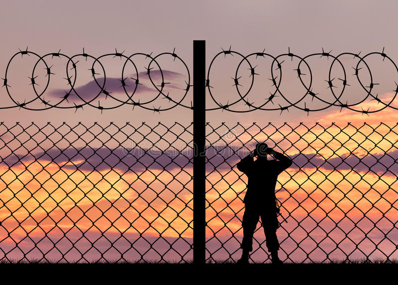 Silhouette of a military border guard royalty free stock image