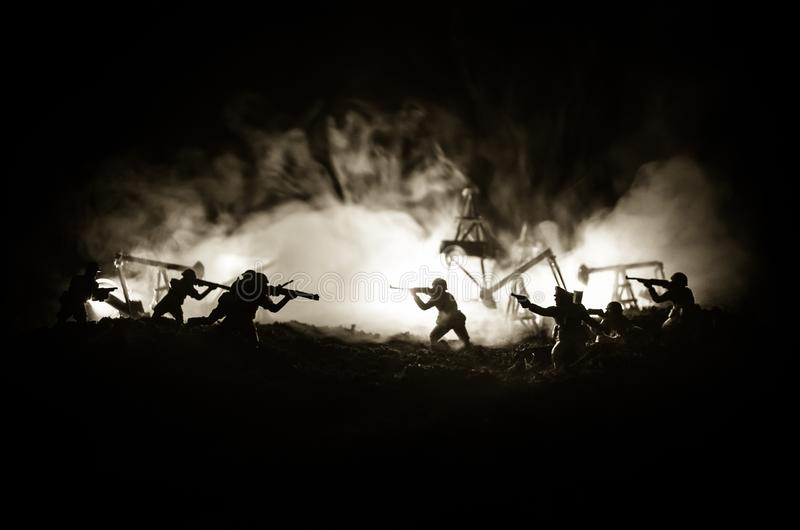 Silhouette of military soldier or officer with weapons. shot, holding gun, colorful sky, background. Oil war and military concept. Selective focus stock images