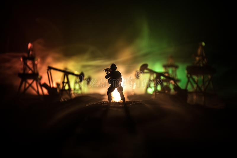 Silhouette of military soldier or officer with weapons. shot, holding gun, colorful sky, background. war and military concept. Artwork decoration. Oil war royalty free stock photos