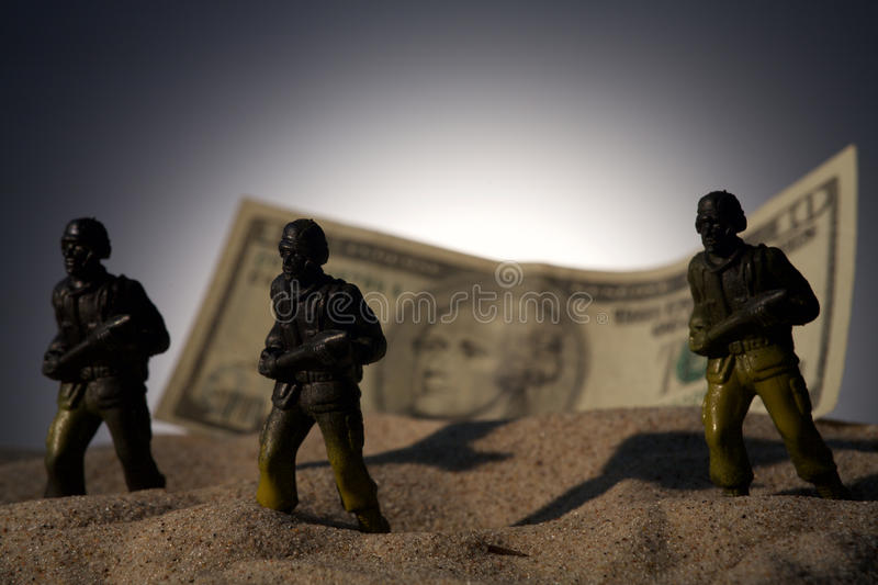 Silhouette of military soldiers on money background stock photo
