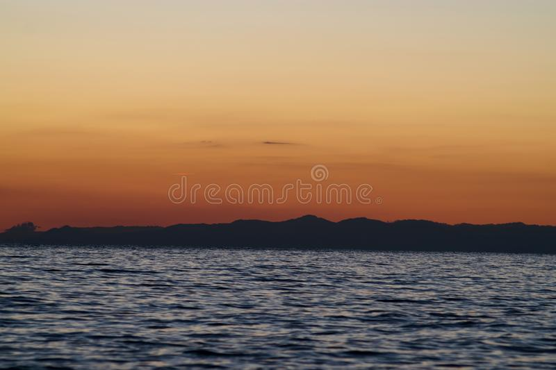 Mountains on the sea stock image