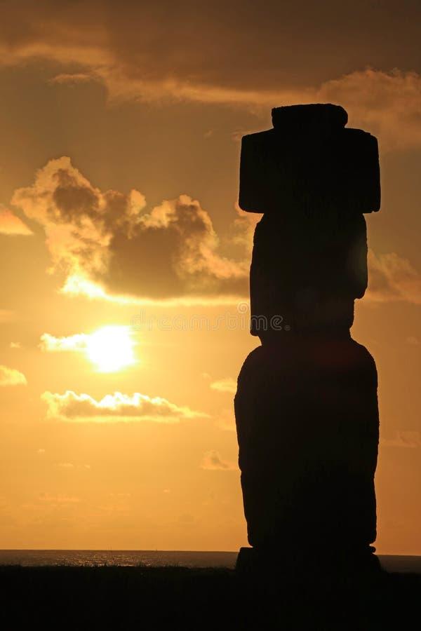 Silhouette of Moai statue against beautiful sunset sky at Ahu Tahai, Easter Island stock photography