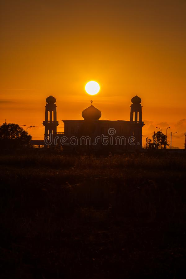 A silhouette of a mosque at sunrise vivid color , Thailand. A silhouette of a mosque at sunrise vivid color , location at Ayutthaya Thailand royalty free stock photography
