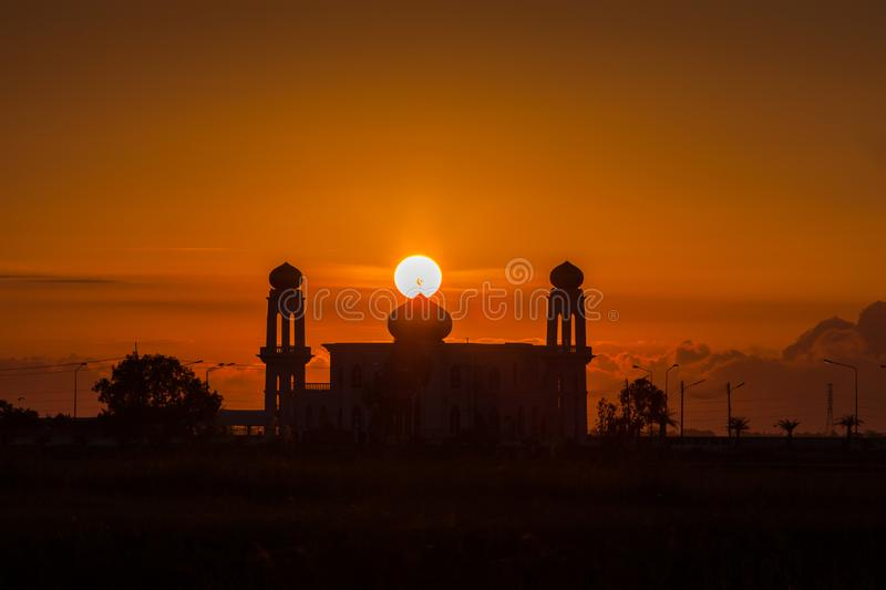 A silhouette of a mosque at sunrise vivid color , Thailand. A silhouette of a mosque at sunrise vivid color , location at Ayutthaya Thailand stock image