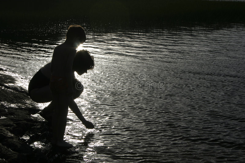 Silhouette of mother and child stock photography