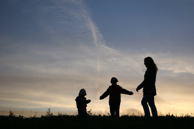 Silhouette mother with children royalty free stock images