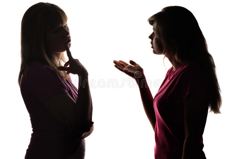 Silhouette mother and daughter dialogue, parent thinks what decision to take. Silhouette on white isolated background mother and daughter dialogue, daughter asks royalty free stock photography