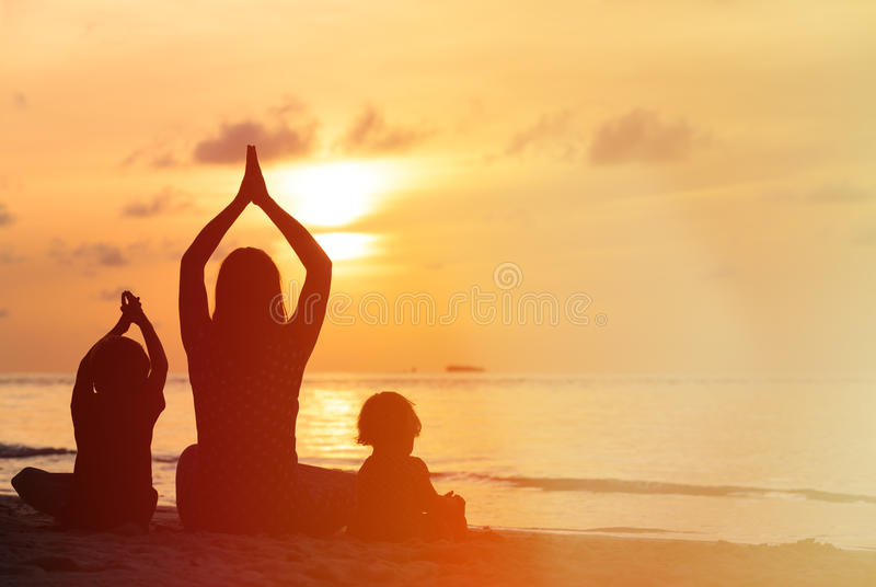 Download Silhouette Of Mother And Kids Doing Yoga At Sunset Stock Image - Image of concentration, child: 58118991