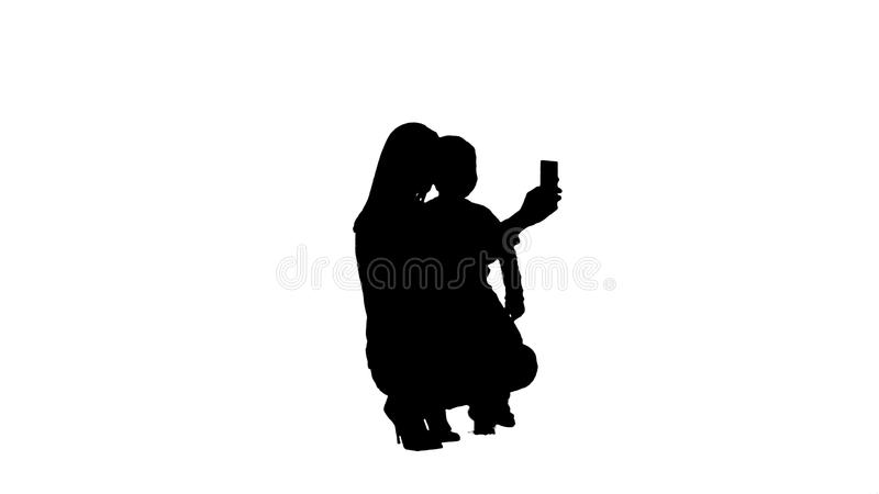 Silhouette Mother And Son Posing For Selfie royalty free illustration