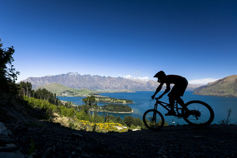 Silhouette of mountain bike rider in Queenstown. New Zealand royalty free stock photos