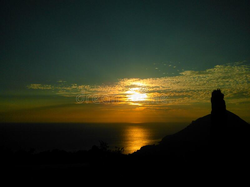 Silhouette Of Mountain Beside Body Of Water During Sunset Free Public Domain Cc0 Image