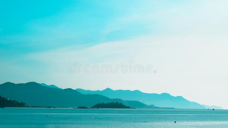 Silhouette of Mountain Near the Body of Water Photo in Daytime royalty free stock photos