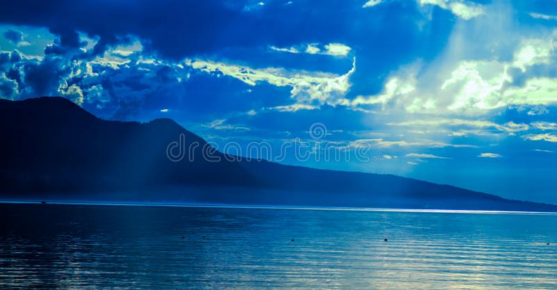 Silhouette of Mountain Near Water at Daytime royalty free stock photo