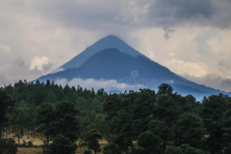 Silhouette of Mountain With Trees Photography stock images