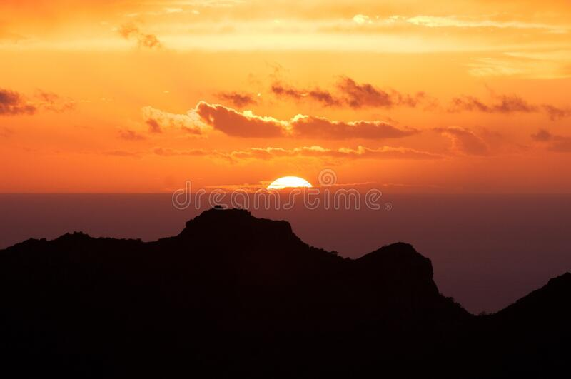 Silhouette of Mountain Under Sunset royalty free stock photos