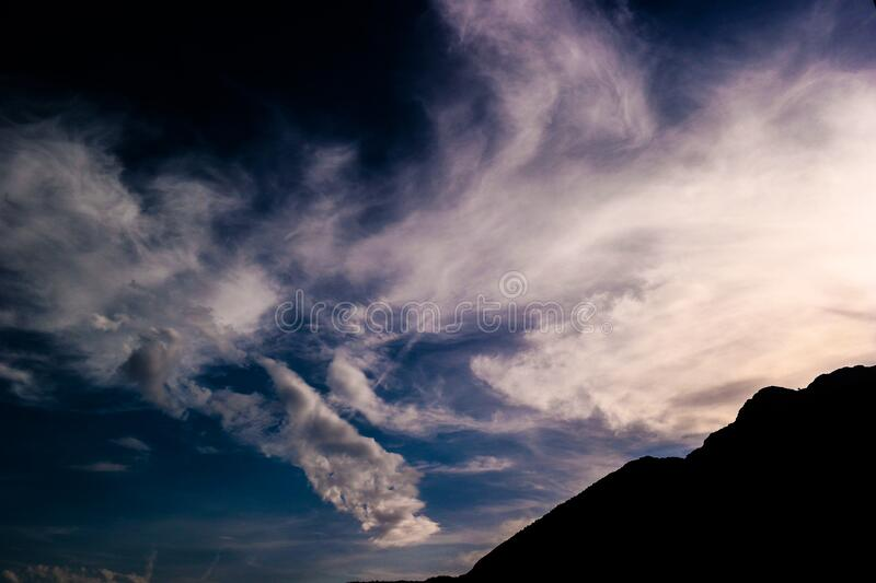 Silhouette of Mountain Under White Clouds stock photo