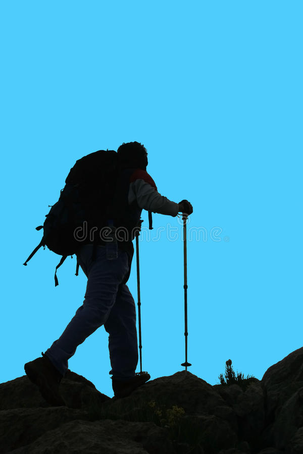 Silhouette of a mountaineer royalty free stock images