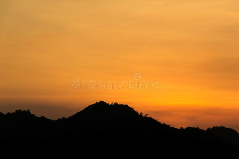 Background of mountain with sunset sky. Silhouette mountainn with background of sunset sky royalty free stock photography