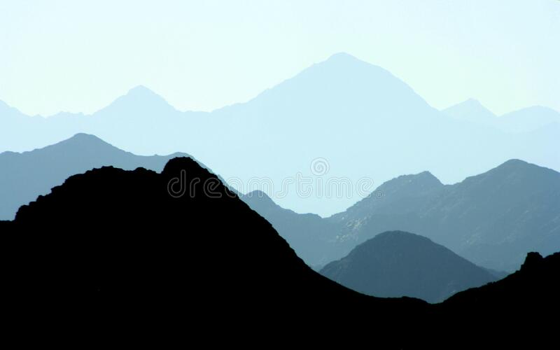 Silhouette of Mountains during Daytime royalty free stock photo