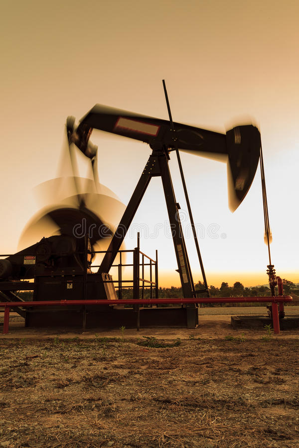 Silhouette Moving Oil Pump Jack stock photos