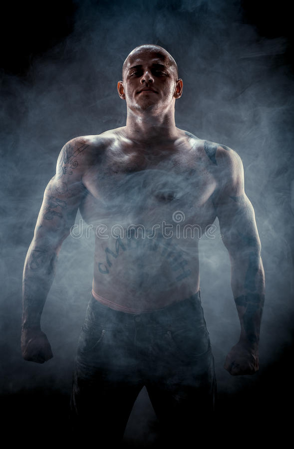 Silhouette of muscular man royalty free stock photography