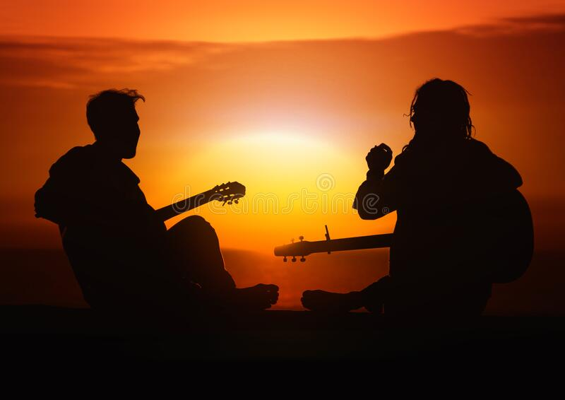 Silhouette of musicians at sunset royalty free stock image