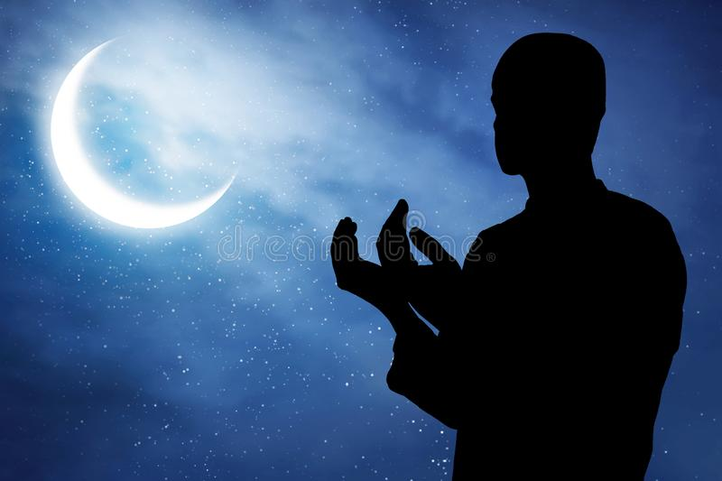 Silhouette of muslim man praying. Silhouette of muslim man pray stock photography
