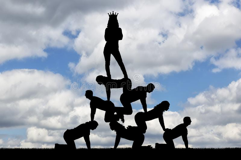 Silhouette narcissistic egoist woman with a crown on his head standing on humans stock photos
